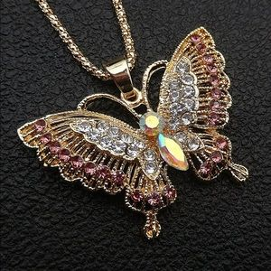 Pink crystal butterfly pendant.